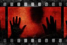 Zwarte silhouet en filmstrook Stock Fotografie