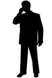 Zwarte silhouetmens op wit stock foto