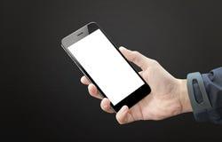 Zwarte slimme telefoon in mensenhand Het lege scherm van mobiel apparaat voor model stock fotografie