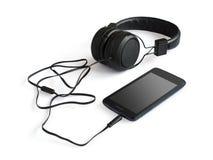 Zwarte smartphone en hoofdtelefoons Stock Fotografie