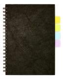 Zwarte spiraalvormige notaboek en post-it Stock Afbeelding