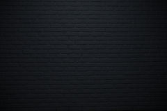 Zwarte steenachtergrond of textuur Stock Foto