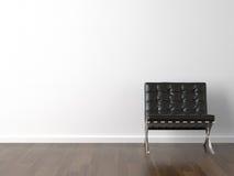 Zwarte stoel op witte muur stock foto