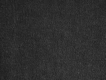 Zwarte stoffenachtergrond Stock Foto's