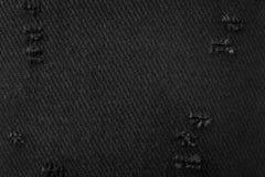 Zwarte stoffentextuur Achtergrond van donker die materiaal van doek wordt gemaakt Gescheurde textiel stock foto