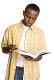 Zwarte studentenlezing Stock Foto's