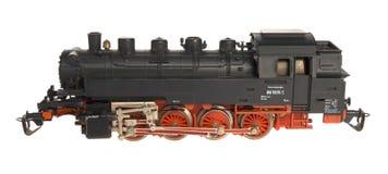 Zwarte stuk speelgoed locomotief Stock Afbeeldingen