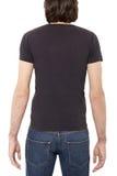 Zwarte t-shirt op mensenrug Stock Foto's