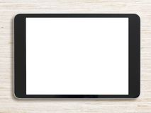 Zwarte tabletpc op gebleekte houten achtergrond Royalty-vrije Stock Fotografie