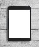 Zwarte tabletpc op houten lijstachtergrond Stock Foto