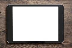 Zwarte tabletpc op oude houten achtergrond Stock Fotografie