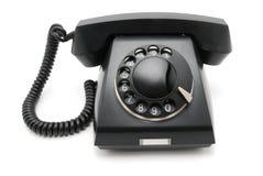Zwarte telefoon met een schijf Stock Fotografie