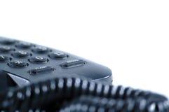 Zwarte telefoon op de witte achtergrond stock foto