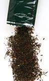 Zwarte thee en een grennzak royalty-vrije stock afbeeldingen