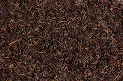 Zwarte thee losse droge theeblaadjes, textuur Royalty-vrije Stock Foto