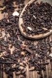 Zwarte theeblaadjes stock afbeeldingen