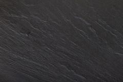 Zwarte van de Rots textuur als achtergrond Stock Foto's