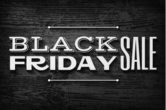 Zwarte vrijdagtekst op vector houten achtergrond Stock Afbeelding