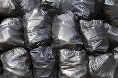 Zwarte vuilniszakken Stock Foto