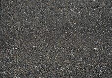 Zwarte wegtextuur als achtergrond, Asfalt Stock Foto's