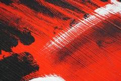Zwarte, witte, rode acrylverf op metaaloppervlakte penseelstreek Stock Foto