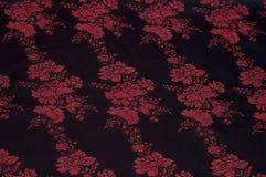 Zwarte zijde met bloemenpatroon Stock Afbeeldingen