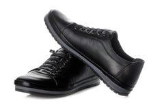 Zwarten` s tennisschoenen De schoenen van vrouwen `s op wit geïsoleerde achtergrond stock foto