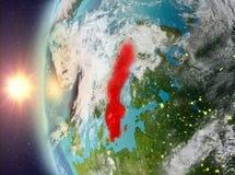 Zweden tijdens zonsondergang van ruimte Stock Fotografie