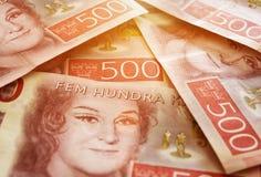 Zweedse geldrekeningen in stapels Stock Foto