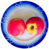 Zwei Äpfel auf der Untertasse Lizenzfreies Stockfoto