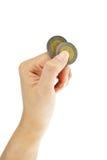 Zwei 10-Baht Münzen mit der Hand Lizenzfreie Stockfotografie