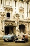 Zwei antike Autos Stockfotos
