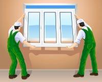 Zwei Arbeitskräfte, die neues Plastikfenster bearbeiten Lizenzfreies Stockfoto