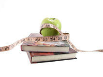 Zwei Bücher und Apfel Stockfoto