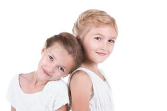 Zwei beste Freunde, die zurück zu Rückseite sitzen lizenzfreie stockfotos