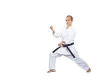Zwei Blöcke von Händen in der Leistung des Athleten im karategi lizenzfreies stockfoto