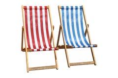 Zwei bunte deckchairs. Stockfotografie