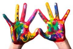 Zwei bunte Hände, die ein Inneres V2 bilden Lizenzfreies Stockfoto