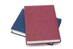 Zwei bunte unbelegte Bücher getrennt auf Weiß Lizenzfreies Stockfoto
