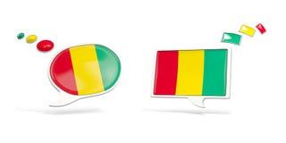 Zwei Chatikonen mit Flagge der Guine stock abbildung