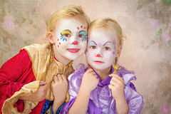Zwei Clownmädchen gemalt Lizenzfreies Stockfoto