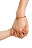 Zwei dazugehörige Hände - klein und groß (Frau) Stockbilder