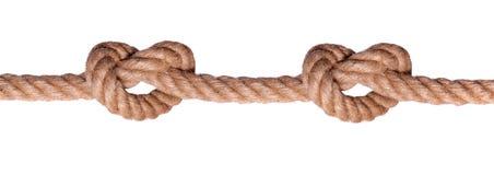 Zwei deckten Knoten auf Seil solch ein Inneres mit Ziegeln Stockbild