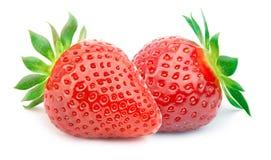 Zwei Erdbeeren mit den Blättern lokalisiert Lizenzfreie Stockfotografie