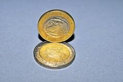 Zwei Euromünzenköpfe stockbilder