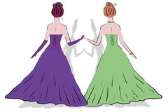 Zwei Frauen am Ball in den Kleidern Stockfotos