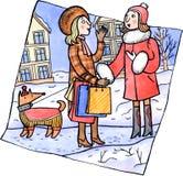 Zwei Frauen, die an der Winterstraße sprechen stock abbildung
