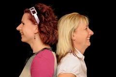 Zwei Frauen zurück zu Rückseite Stockfotos