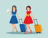 Zwei Freundinnen mit Gepäck am Flughafen Stockbild