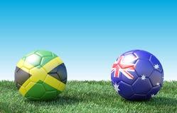 Zwei Fußbälle in den Flaggenfarben auf grünem Gras vektor abbildung
